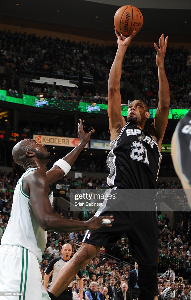 Tim Duncan #21 of the San Antonio Spurs shoots the ball against Kevin Garnett #5 of the Boston Celtics on November 21, 2012 at the TD Garden in Boston, Massachusetts.