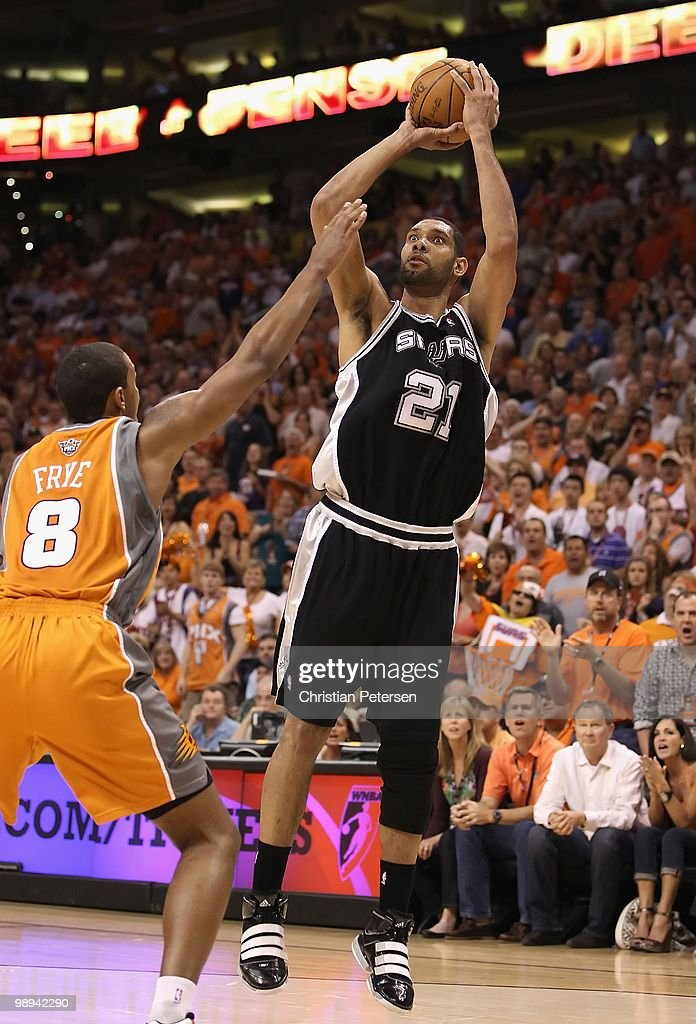 Tim Duncan #21 of the San Antonio Spurs shoots the ball during Game Two of the Western Conference Semifinals of the 2010 NBA Playoffs against the Phoenix Suns at US Airways Center on May 5, 2010 in Phoenix, Arizona. The team is wearing 'Los Suns' jerseys on Cinco de Mayo in response to an anti-immigration law recently passed in Arizona. The Suns defeated the Spurs 110-102 to take a 2-0 series lead.