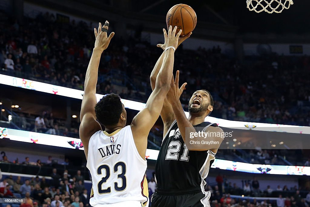 Tim Duncan #21 of the San Antonio Spurs shoots the ball over Anthony Davis #23 of the New Orleans Pelicans at Smoothie King Center on December 26, 2014 in New Orleans, Louisiana.