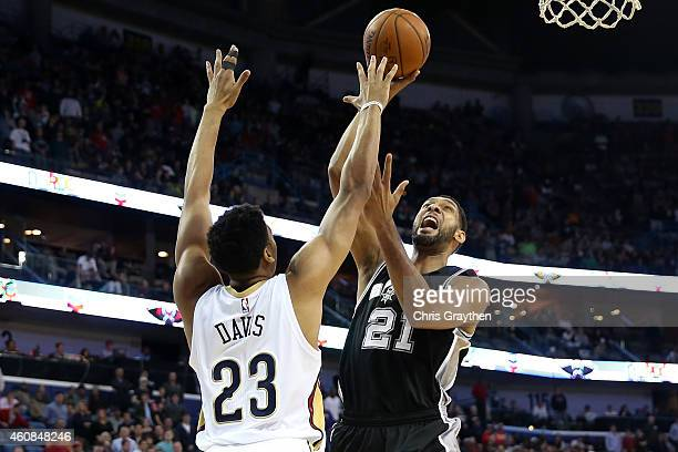 Tim Duncan of the San Antonio Spurs shoots the ball over Anthony Davis of the New Orleans Pelicans at Smoothie King Center on December 26 2014 in New...