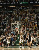 Tim Duncan of the San Antonio Spurs shoots the game winning shot over Vitaly Potapenko of the Seattle SuperSonics 9896 in Game 6 of the Western...