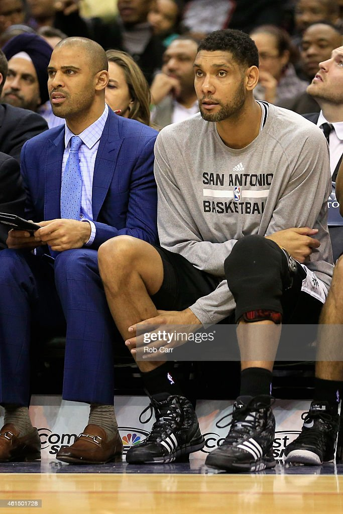 Tim Duncan #21 of the San Antonio Spurs sits on the bench during the second half of the Spurs 101-93 loss to the Washington Wizards at Verizon Center on January 13, 2015 in Washington, DC.