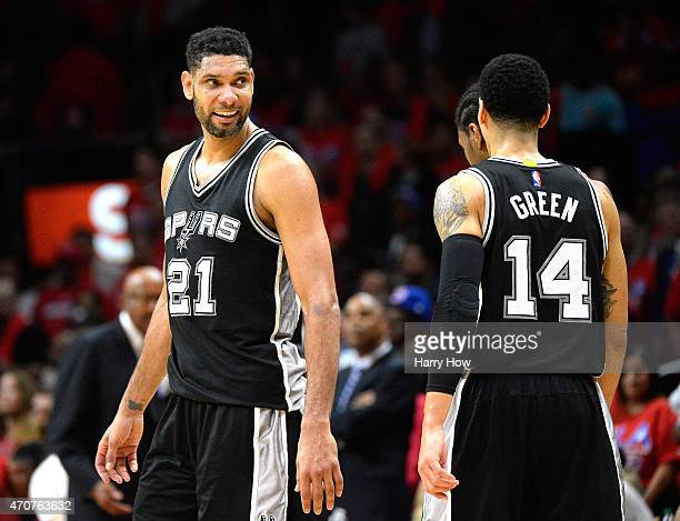 Tim Duncan of the San Antonio Spurs smiles at Danny Green leading the Los Angeles Clippers in overtime during Game Two of the Western Conference...