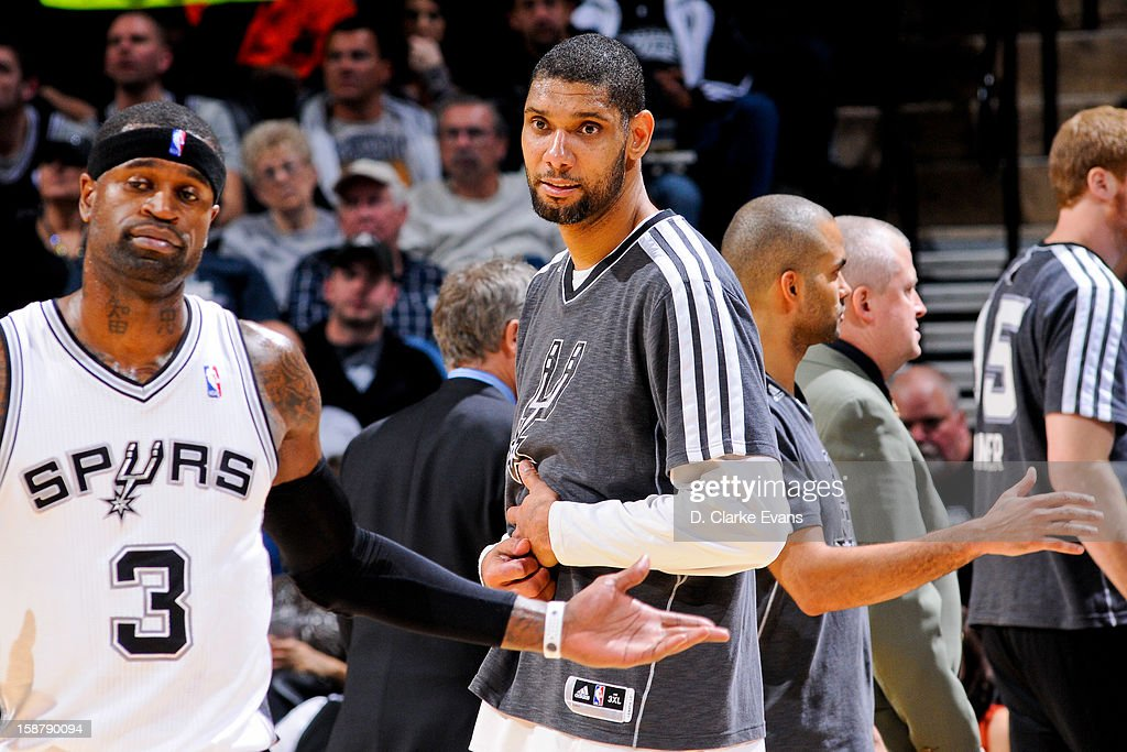 Tim Duncan #21 of the San Antonio Spurs smiles during a game against the Houston Rockets on December 28, 2012 at the AT&T Center in San Antonio, Texas.