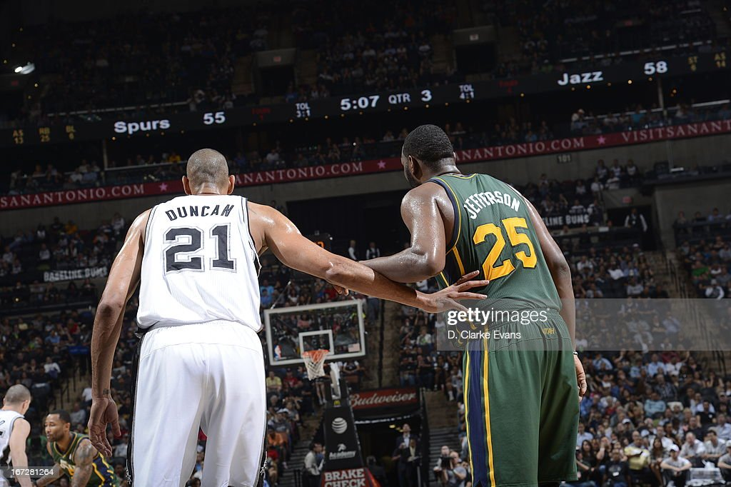 <a gi-track='captionPersonalityLinkClicked' href=/galleries/search?phrase=Tim+Duncan&family=editorial&specificpeople=201467 ng-click='$event.stopPropagation()'>Tim Duncan</a> #21 of the San Antonio Spurs stands in the paint with <a gi-track='captionPersonalityLinkClicked' href=/galleries/search?phrase=Al+Jefferson&family=editorial&specificpeople=201604 ng-click='$event.stopPropagation()'>Al Jefferson</a> #25 of the Utah Jazz on March 22, 2013 at the AT&T Center in San Antonio, Texas.