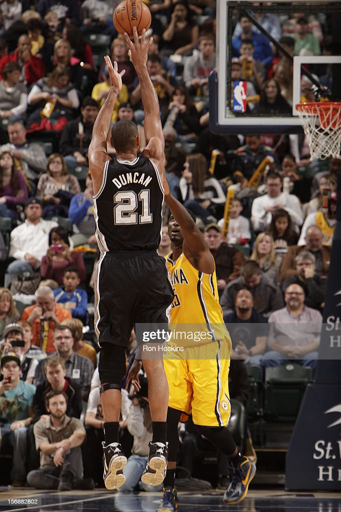 Tim Duncan #21 of the San Antonio Spurs takes a deep jumpshot vs the Indiana Pacers on November 23, 2012 at Bankers Life Fieldhouse in Indianapolis, Indiana.