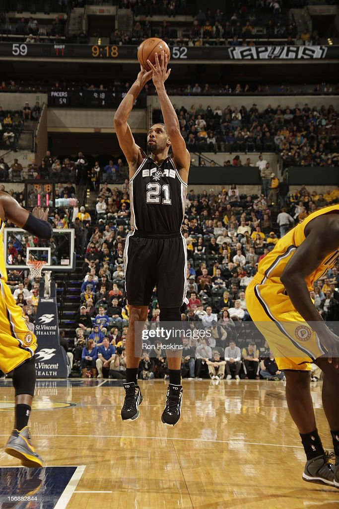 Tim Duncan #21 of the San Antonio Spurs takes a jumpshot vs the Indiana Pacers on November 23, 2012 at Bankers Life Fieldhouse in Indianapolis, Indiana.