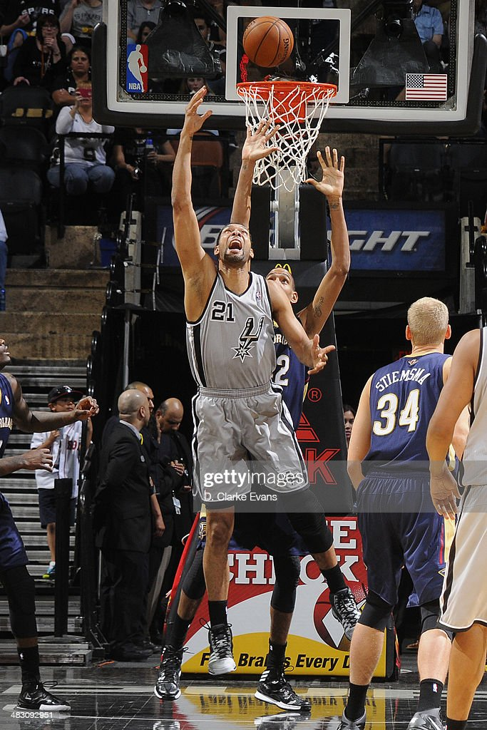 <a gi-track='captionPersonalityLinkClicked' href=/galleries/search?phrase=Tim+Duncan&family=editorial&specificpeople=201467 ng-click='$event.stopPropagation()'>Tim Duncan</a> #21 of the San Antonio Spurs takes a shot against the New Orleans Pelicans at the AT&T Center on March 29, 2014 in San Antonio, Texas.