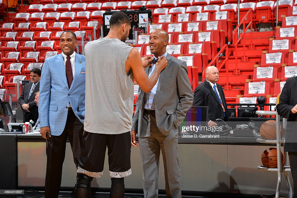 <a gi-track='captionPersonalityLinkClicked' href=/galleries/search?phrase=Tim+Duncan&family=editorial&specificpeople=201467 ng-click='$event.stopPropagation()'>Tim Duncan</a> #21 of the San Antonio Spurs talks with <a gi-track='captionPersonalityLinkClicked' href=/galleries/search?phrase=Bruce+Bowen&family=editorial&specificpeople=201662 ng-click='$event.stopPropagation()'>Bruce Bowen</a> before Game Three of the 2014 NBA Finals against the Miami Heat on June 10, 2014 at American Airlines Arena in Miami, Florida.
