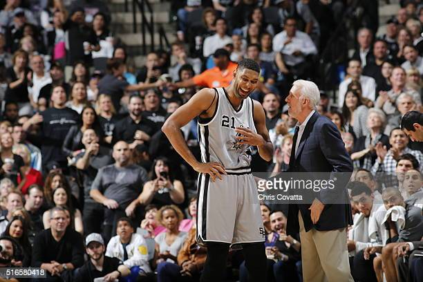 Tim Duncan of the San Antonio Spurs talks with Head Coach Gregg Popovich of the San Antonio Spurs during the game against the Golden State Warriors...