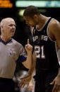 Tim Duncan of the San Antonio Spurs talks with official Joe Crawford in Game five of the 2003 NBA Finals against the New Jersey Nets at Continental...