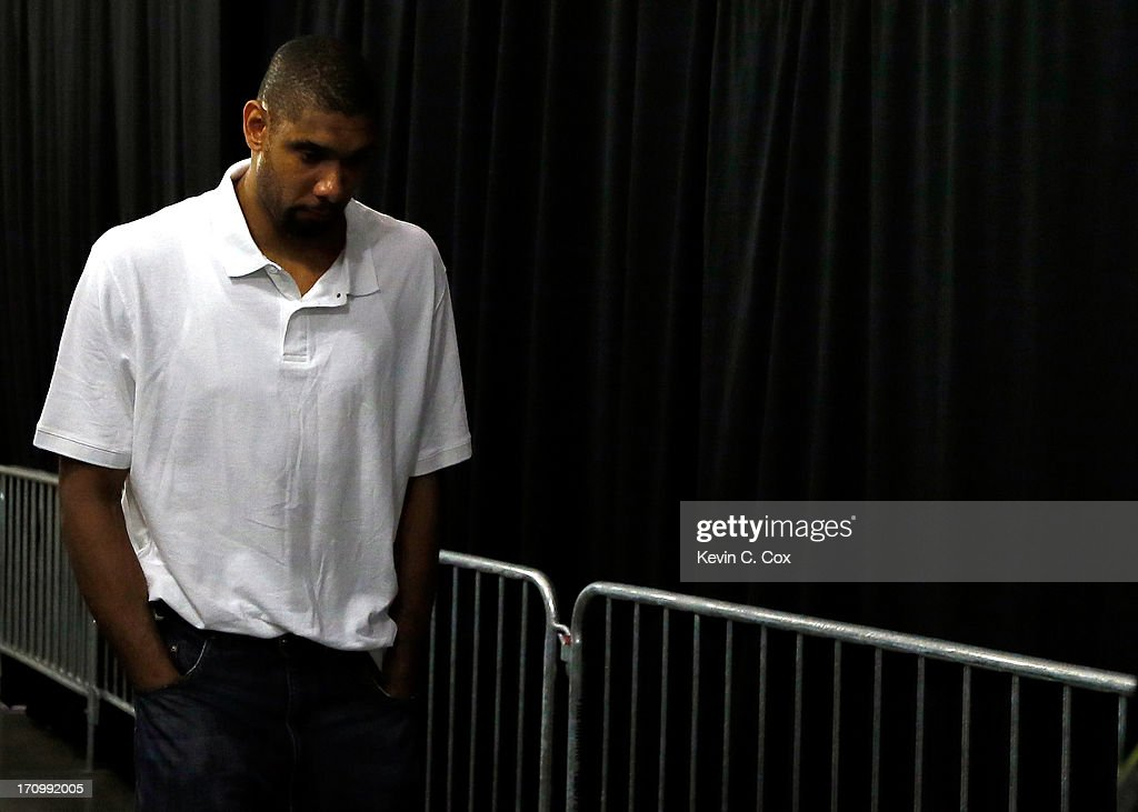 Tim Duncan #21 of the San Antonio Spurs walks through the tunnel towards the exit after losing to the Miami Heat 95-88 in Game Seven of the 2013 NBA Finals at AmericanAirlines Arena on June 20, 2013 in Miami, Florida.