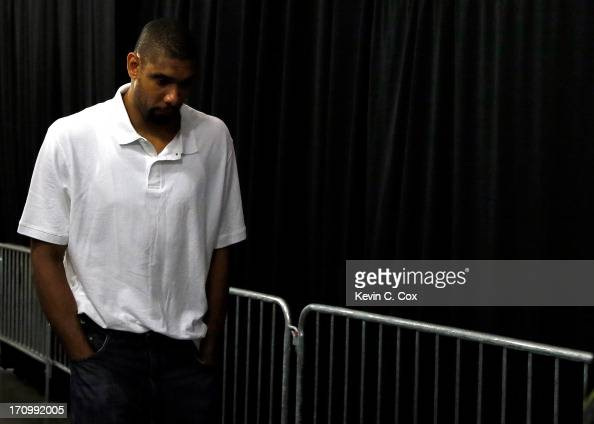 Tim Duncan of the San Antonio Spurs walks through the tunnel towards the exit after losing to the Miami Heat 9588 in Game Seven of the 2013 NBA...