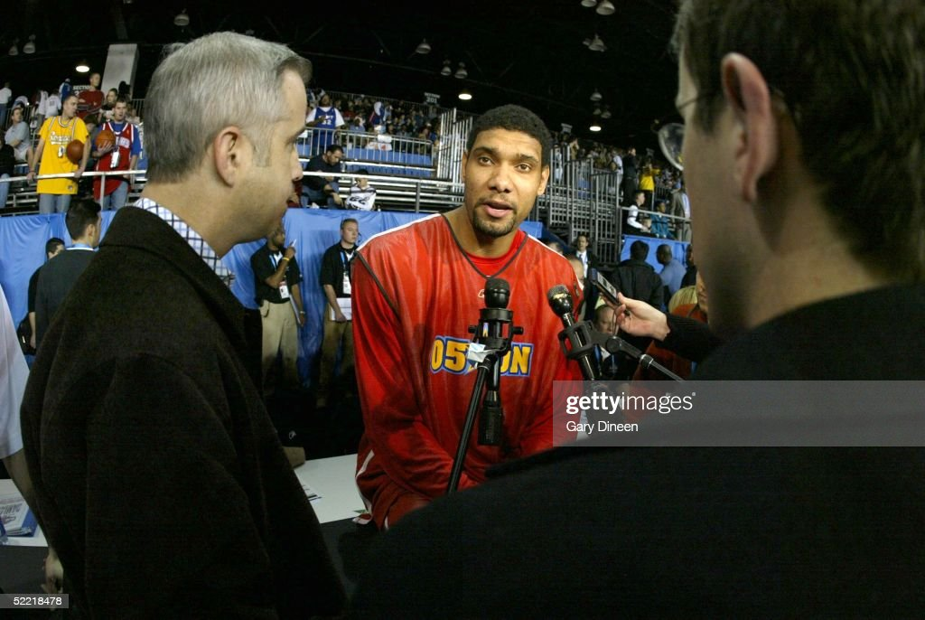 Tim Duncan of the West answers questions from the media on Center Court of Jam Session in the Colorado Convention Center during 2005 NBA AllStar...