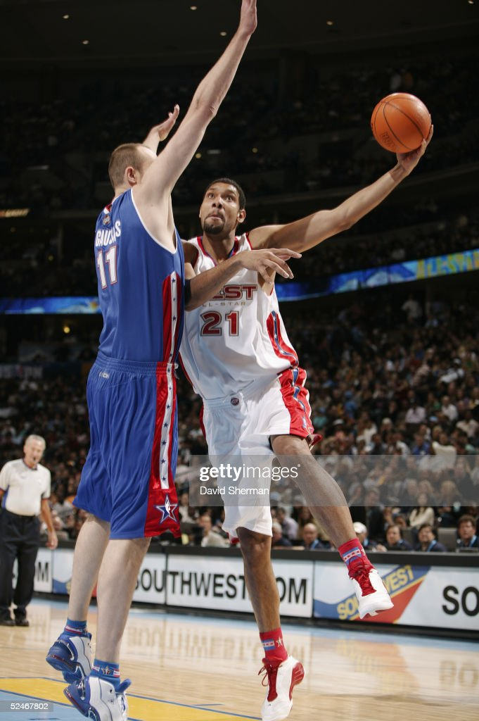 <a gi-track='captionPersonalityLinkClicked' href=/galleries/search?phrase=Tim+Duncan&family=editorial&specificpeople=201467 ng-click='$event.stopPropagation()'>Tim Duncan</a> #21 of the Western Conference All-Stars shoots against Zydrunas Ilgauskas #11 of the Eastern Conference All-Stars during the 54th All-Star Game, part of 2005 NBA All-Star Weekend at Pepsi Center on February 20, 2005 in Denver, Colorado. The East won 125-115.