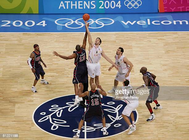 Tim Duncan of United States and Pau Gasol of Spain tip off to start the second half of the men's basketball quarterfinal game on August 26 2004...