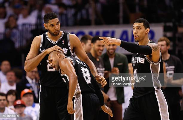 Tim Duncan Patty Mills and Danny Green of the San Antonio Spurs celebrate a play against the Oklahoma City Thunder in the second half during Game Six...