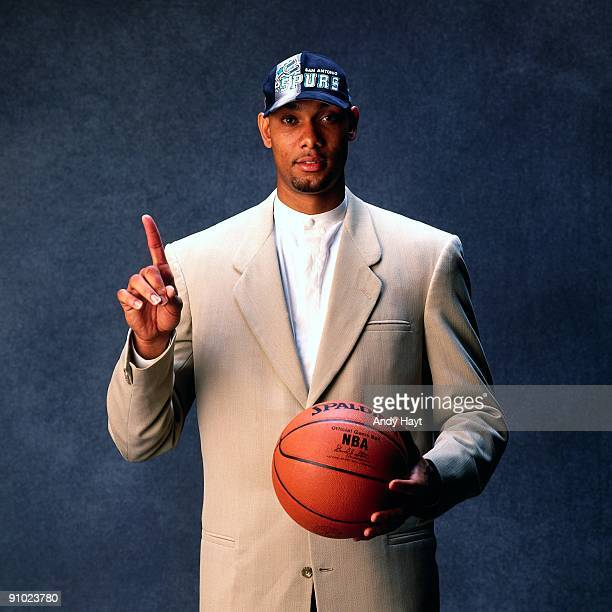 Tim Duncan poses for a photo after being selected by the San Antonio Spurs at the 1997 NBA Draft in New York New York NOTE TO USER User expressly...