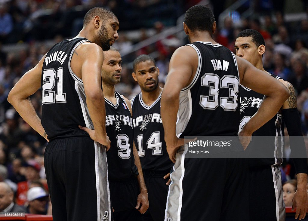 Tim Duncan #21, Tony Parker #9, Gary Neal #14, Boris Diaw #33 and Danny Green #4 of the San Antonio Spurs meet before the whistle against the Los Angeles Clippers at Staples Center on February 21, 2013 in Los Angeles, California.