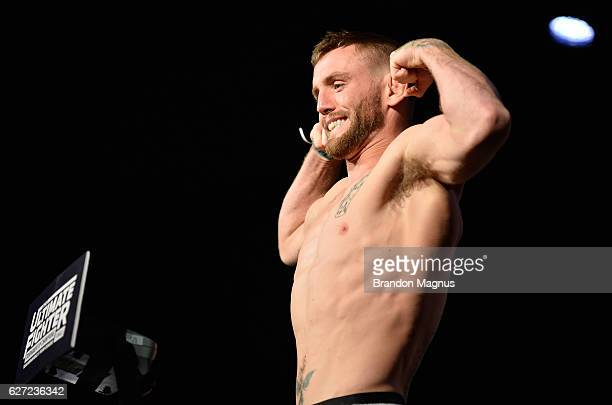 Tim Elliott steps onto the scale during the TUF Finale weighin in the Palms Resort Casino on December 2 2016 in Las Vegas Nevada