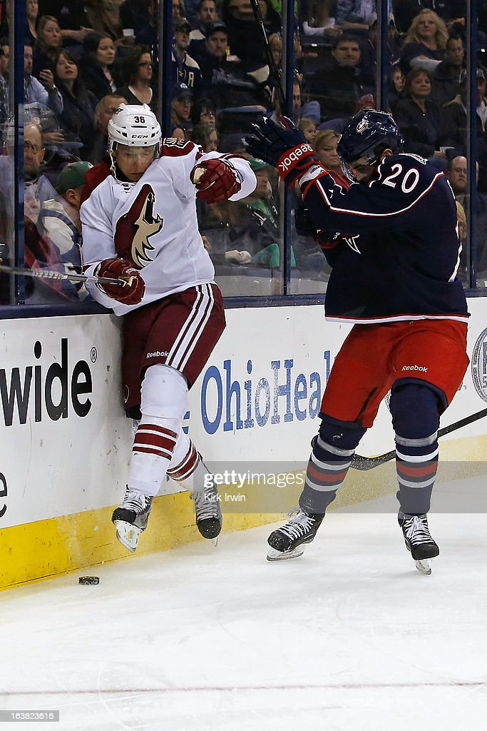 Tim Erixon #20 of the Columbus Blue Jackets checks Rob Klinkhammer #36 of the Phoenix Coyotes while chasing after a loose puck during the first period on March 16, 2013 at Nationwide Arena in Columbus, Ohio.
