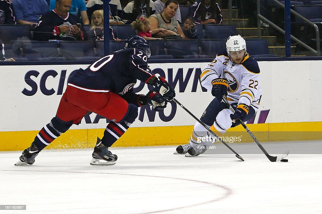 Tim Erixon #20 of the Columbus Blue Jackets defends against Johan Larsson #22 of the Buffalo Sabres on September, 2013 at Nationwide Arena in Columbus, Ohio.