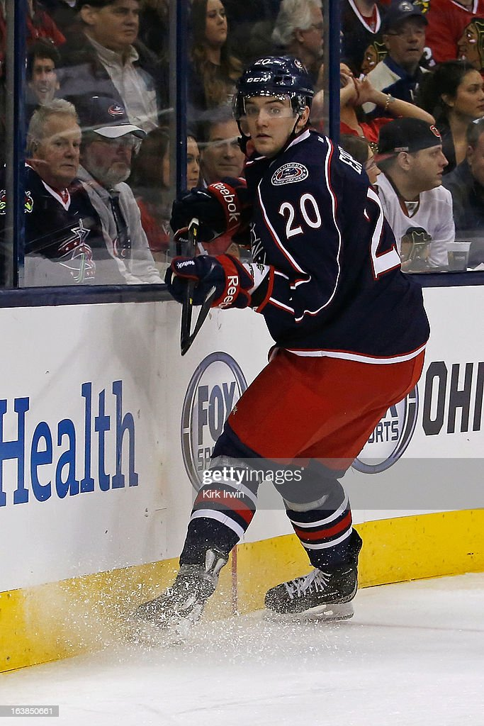 Tim Erixon #20 of the Columbus Blue Jackets skates after a loose puck during the game against the Chicago Blackhawks on March 14, 2013 at Nationwide Arena in Columbus, Ohio.