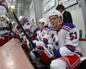 Tim Erixon of the New York Rangers sits on the bench during the NHL Prospects Tournament on September 13 2011 in Traverse City Michigan