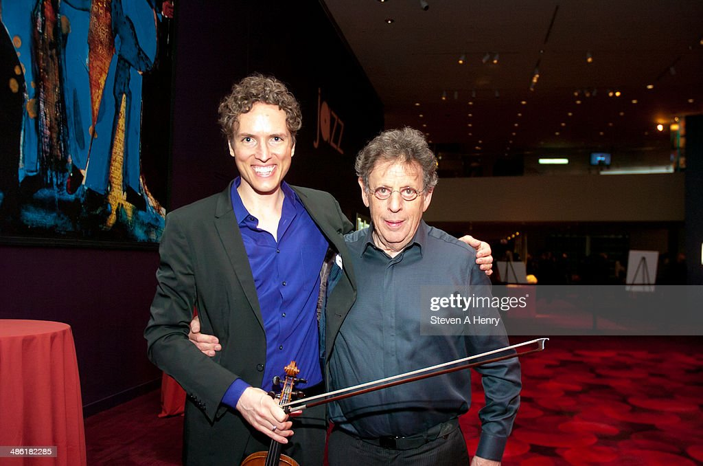 Tim Fain and <a gi-track='captionPersonalityLinkClicked' href=/galleries/search?phrase=Philip+Glass&family=editorial&specificpeople=241461 ng-click='$event.stopPropagation()'>Philip Glass</a> attend the 2014 Kids In Need Of Defense Gala Benefit Dinner at Frederick P. Rose Hall, Jazz at Lincoln Center on April 22, 2014 in New York City.