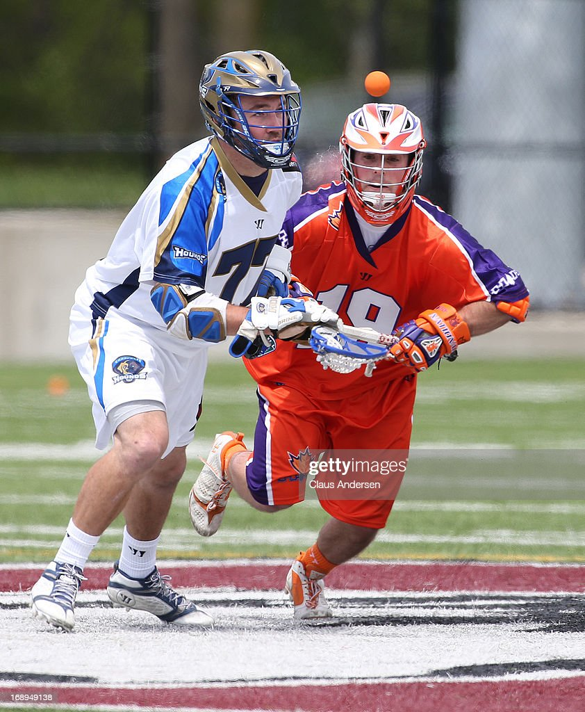 Tim Fallon #77 of the Charlotte Hounds battles against Matt Dolente #19 of the Hamilton Nationals in a Major League Lacrosse game at Ron Joyce Stadium in Hamilton, Ontario, Canada. The Nationals defeated the Hounds 16-15 in overtime.