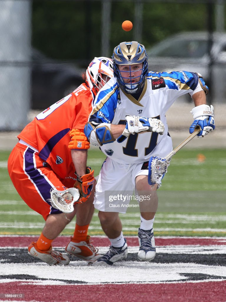 Tim Fallon #77 of the Charlotte Hounds grabs a loose ball from the faceoff against the Hamilton Nationals in a Major League Lacrosse game at Ron Joyce Stadium in Hamilton, Ontario, Canada. The Nationals defeated the Hounds 16-15 in overtime.