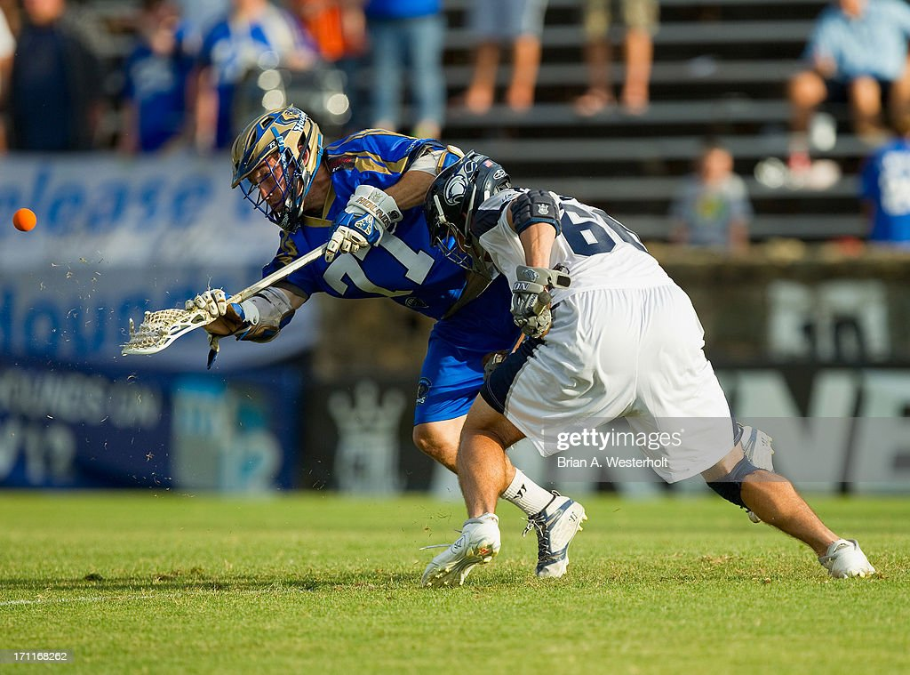 Tim Fallon #77 of the Charlotte Hounds wins the faceoff against Mike Simon #66 of the Chesapeake Bayhawks at American Legion Memorial Stadium on June 22, 2013 in Charlotte, North Carolina. The Hounds defeated the Bayhawks 16-15 in overtime.