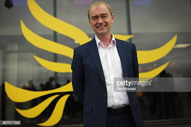 Tim Farron leader of the Liberal Democrats poses outside the Brighton Conference Centre on September 17 2016 in Brighton England The Liberal...