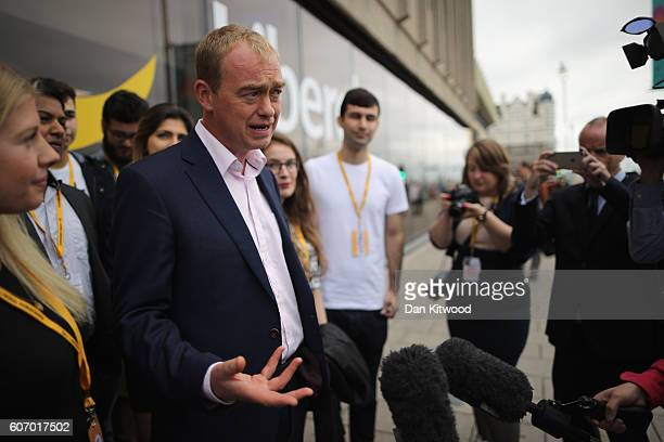 Tim Farron leader of the Liberal Democrats speeks to members of the media outside the Brighton Conference Centre on September 17 2016 in Brighton...