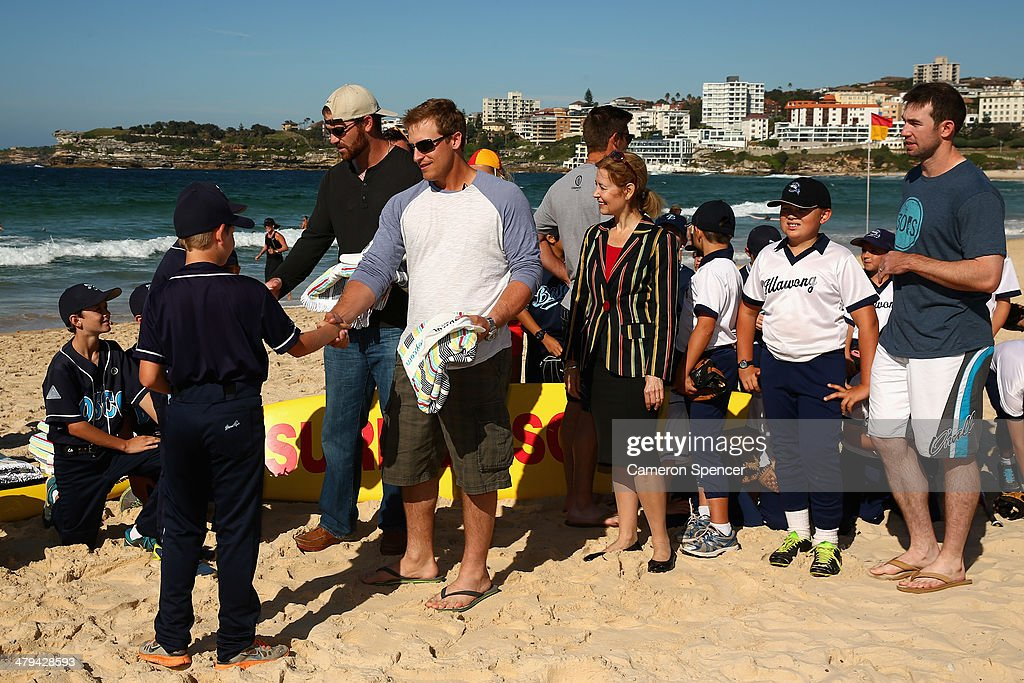 Tim Federowicz and Chris Withrow of the Los Angeles Dodgers receive gifts from players from Illawong and St John Bosco Little League during a Los Angeles Dodgers players visit at Bondi Beach on March 19, 2014 in Sydney, Australia.