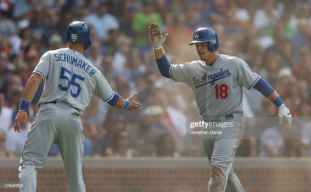 Tim Federowicz #18 of the Los Angeles Dodgers celebrates with <a gi-track='captionPersonalityLinkClicked' href=/galleries/search?phrase=Skip+Schumaker&family=editorial&specificpeople=640599 ng-click='$event.stopPropagation()'>Skip Schumaker</a> #55 after both players scored runs in the 6th inning against the Chicago Cubs at Wrigley Field on August 3, 2013 in Chicago, Illinois. The Dodgers defeated the Cubs 3-0.