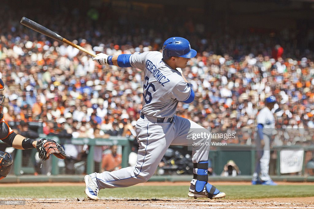 Tim Federowicz #26 of the Los Angeles Dodgers hits an RBI single against the San Francisco Giants during the second inning at AT&T Park on April 17, 2014 in San Francisco, California.
