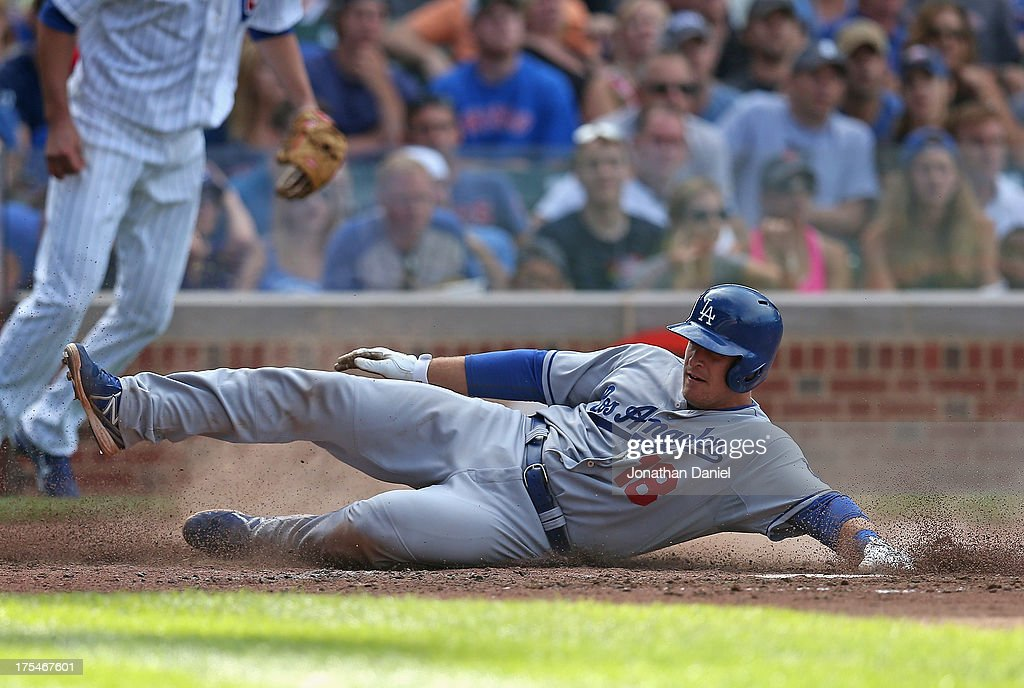 Tim Federowicz #18 of the Los Angeles Dodgers slides across home plate to score a run in the 6th inning against the Chicago Cubs at Wrigley Field on August 3, 2013 in Chicago, Illinois. The Dodgers defeated the Cubs 3-0.