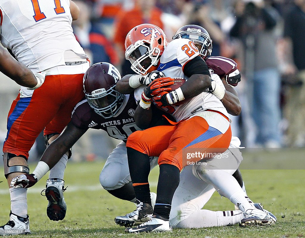 Tim Flanders #20 of the Sam Houston State Bearkats is tackled by Shaun Ward #40 of the Texas A&M Aggies at Kyle Field on November 17, 2012 in College Station, Texas.