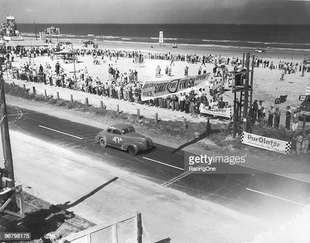 Tim Flock crosses the startfinish line during one of the early races on the Daytona BeachRoad Course