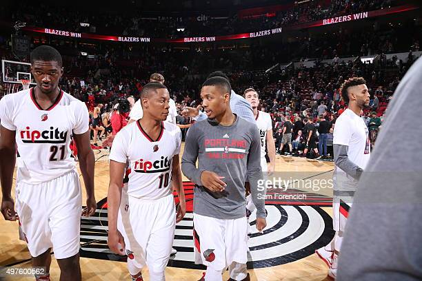 Tim Frazier and Damian Lillard of the Portland Trail Blazers have a small chat before the game against the Memphis Grizzlies on November 5 2015 at...