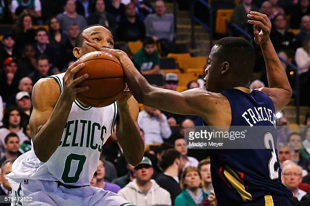 Tim Frazier of the New Orleans Pelicans blocks a shot by Avery Bradley of the Boston Celtics during the fourth quarter at TD Garden on April 6 2016...
