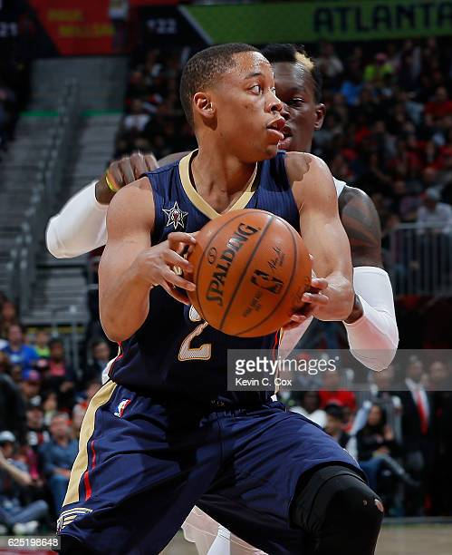 Tim Frazier of the New Orleans Pelicans draws a foul from Dennis Schroder of the Atlanta Hawks at Philips Arena on November 22 2016 in Atlanta...
