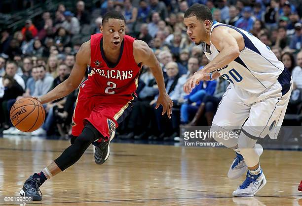 Tim Frazier of the New Orleans Pelicans drives the ball down court against Seth Curry of the Dallas Mavericks at American Airlines Center on November...