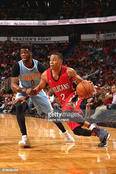 Tim Frazier of the New Orleans Pelicans handles the ball against the Denver Nuggets on October 26 2016 at the Smoothie King Center in New Orleans...