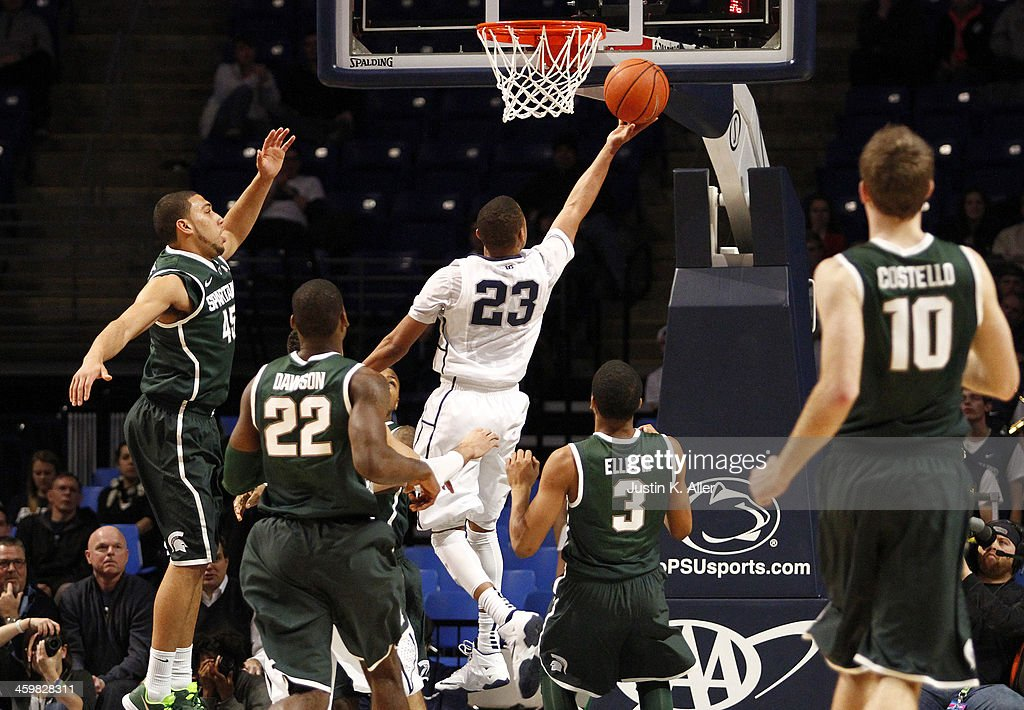 Tim Frazier #23 of the Penn State Nittany Lions goes up for a layup against the Michigan State Spartans at the Bryce Jordan Center on December 31, 2013 in State College, Pennsylvania.