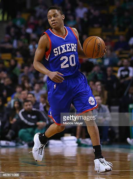 Tim Frazier of the Philadelphia 76ers carries the ball against the Boston Celtics during the first quarter at TD Garden on February 6 2015 in Boston...