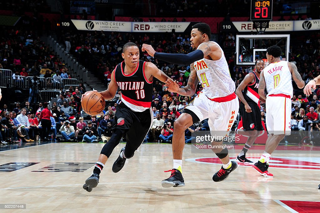 <a gi-track='captionPersonalityLinkClicked' href=/galleries/search?phrase=Tim+Frazier&family=editorial&specificpeople=6526834 ng-click='$event.stopPropagation()'>Tim Frazier</a> #10 of the Portland Trail Blazers drives to the basket during the game against the Atlanta Hawks on December 21, 2015 at Philips Arena in Atlanta, Georgia.