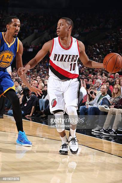 Tim Frazier of the Portland Trail Blazers handles the ball against the Golden State Warriors during a preseason game on October 8 2015 at the Moda...