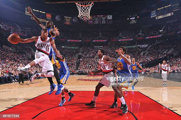 Tim Frazier of the Portland Trail Blazers looks to pass against the Golden State Warriors during a preseason game on October 8 2015 at the Moda...